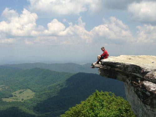 man sitting rock