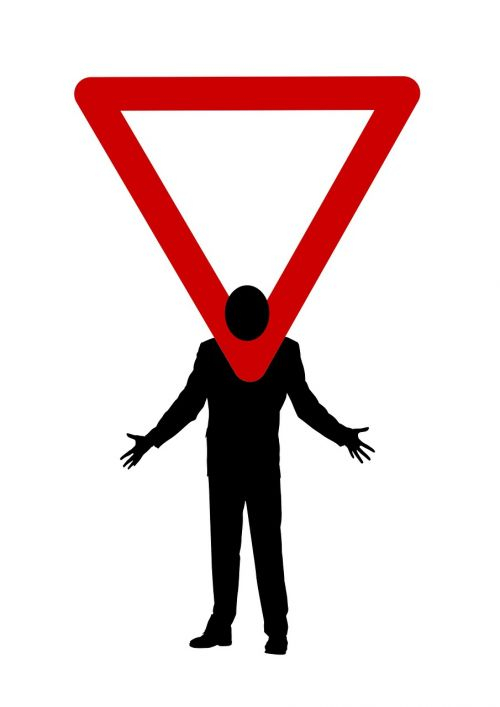 man silhouette road sign