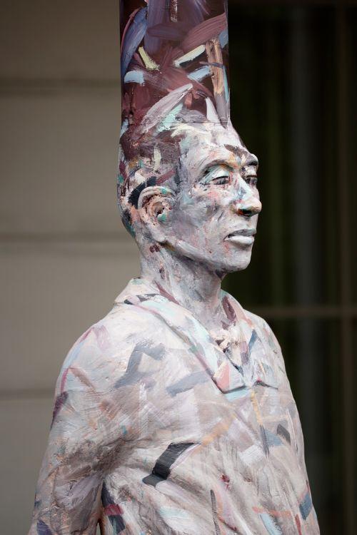 man men sculpture contrast