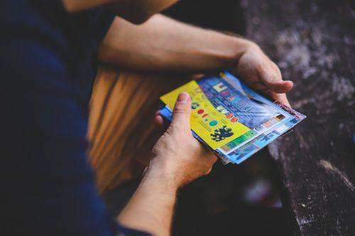 man viewing postcards