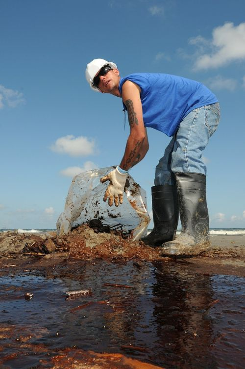 man worker oil cleanup