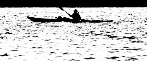 Man In Kayak On Water