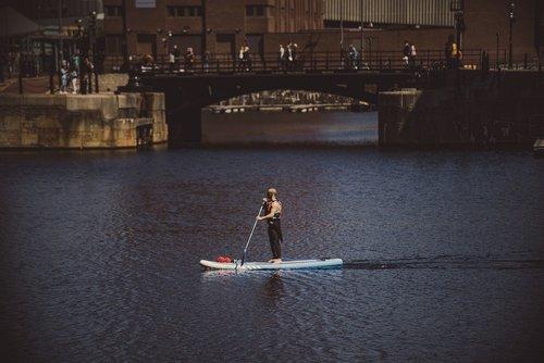 man kayaking in albert docks  liverpool  england