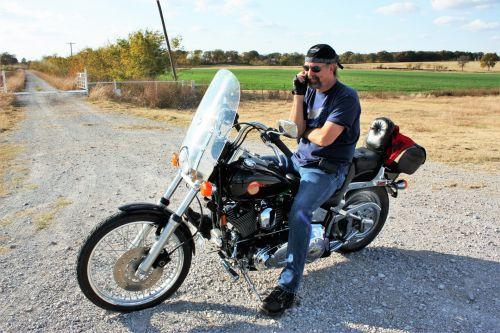 Man On Motorcycle On Phone