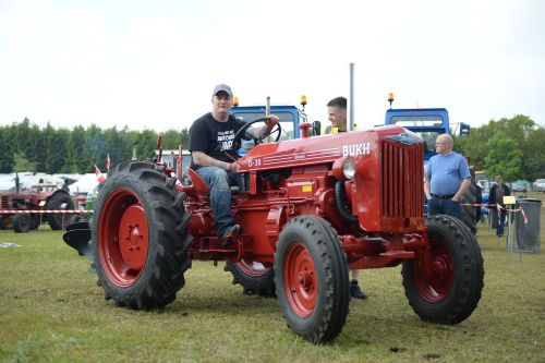man on tractor red tractor old tractor