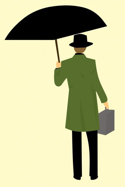 man return coat holding umbrella
