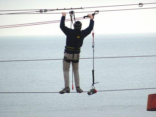 Man Servicing Zip Line Cables