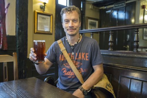 Man With English Pint Of Lager