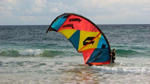 man with kyte kite kite surfing