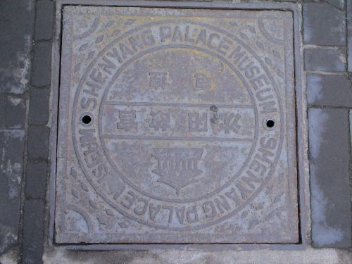 manhole cover metal road