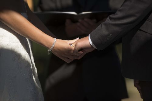 marriage connect holding hands