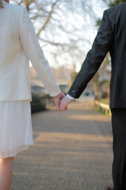 marrried couple holding hands
