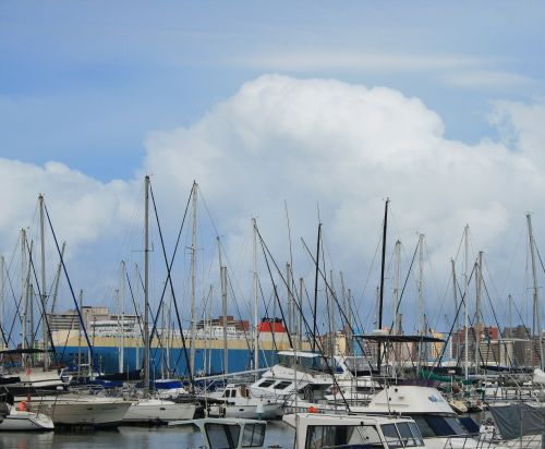 Masts Of Yachts Against Cloudy Sky
