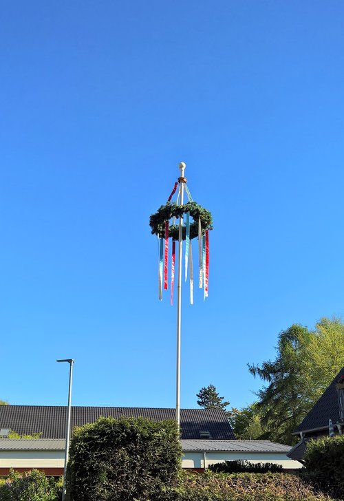 maypole  decorated wreath  hung