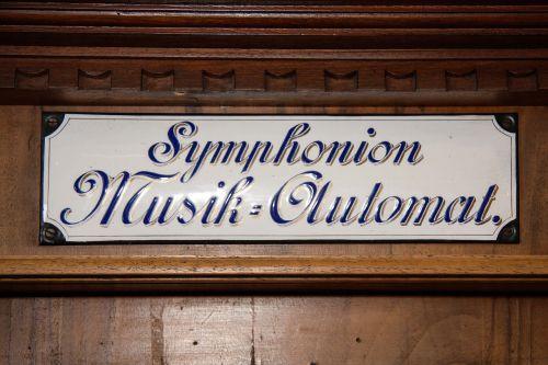 mechanical musical instruments symphoniun enamel sign