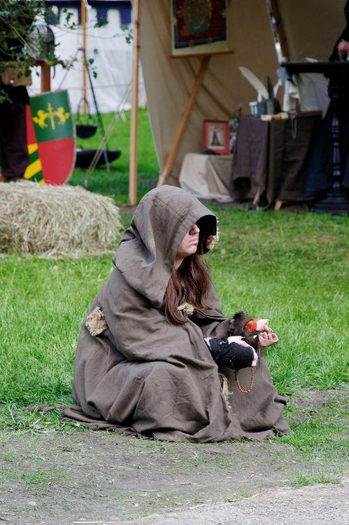 medieval market beggars sit