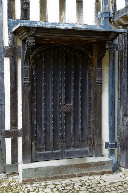 medieval oak door and surround canopy lead roof