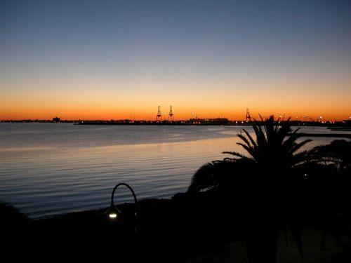 Melburnas,saulėlydis,uostas
