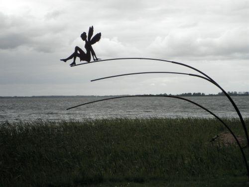 metal art elf on the water