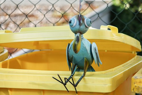 metal bird  dustbin  yellow ton