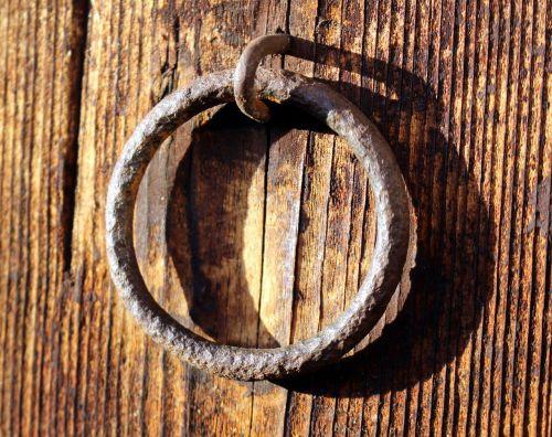 metal ring fitting wooden door