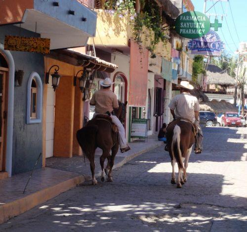 mexican cowboys horses