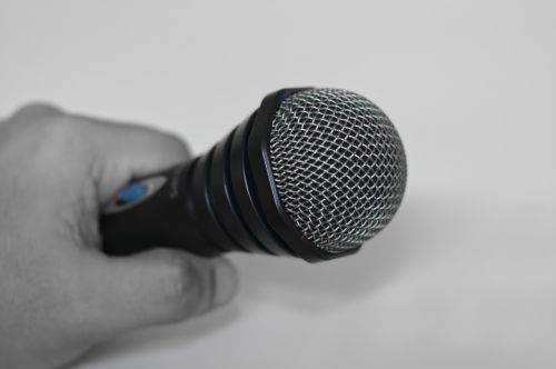 microphone hand holding microphone speaker