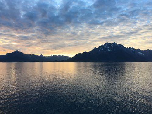 midnight sun fjords sea