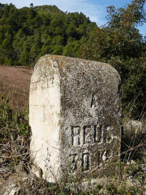 milestone boundary stone road