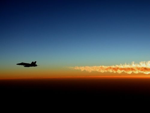 military jet silhouette sunset