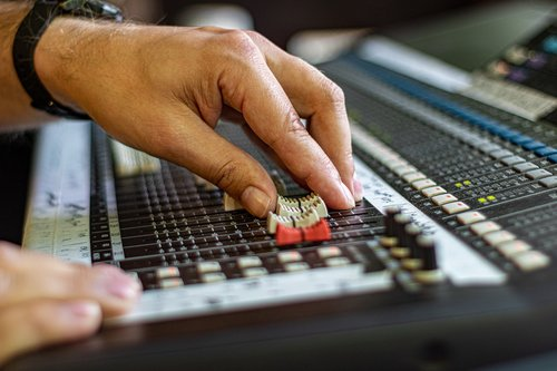 mixing console  hands  sound