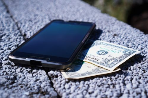 mobile phone money banknotes