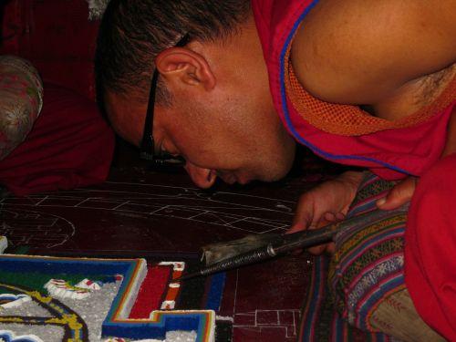 monk preparing mandala mandala spituk monastery