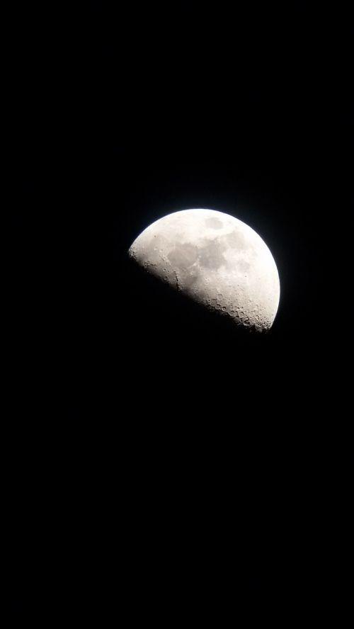 moon half illuminated heaven