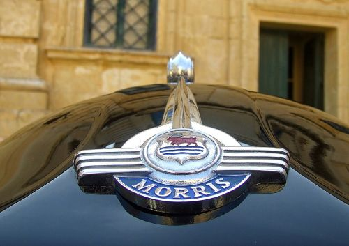 morris minor,morris car,car badge,morris minor 1000,bonnet,hood,front,minor,car,vehicle,old,transport,english,british,classic,classic car,vintage car,vetran car,vintage,vetran,chrome,chrome badge,black,1000,oxford,cowley,shiny,restored,transportation,uk,retro,traditional,britain,symbol