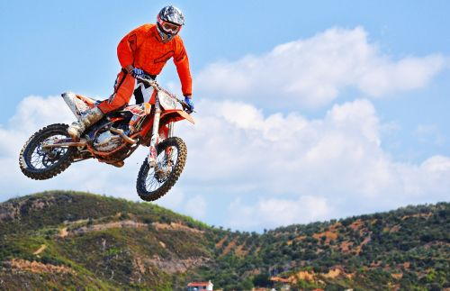 motocross rider jump dirt bike