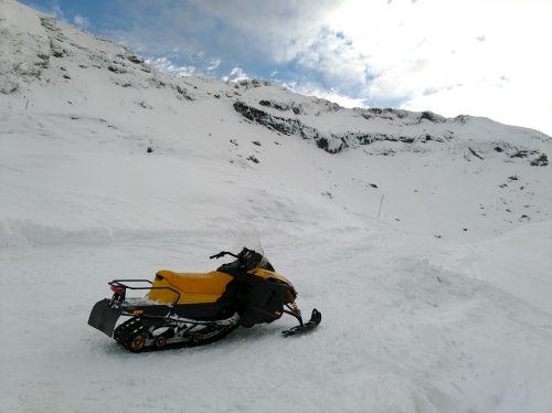 mountain snow snowmobile