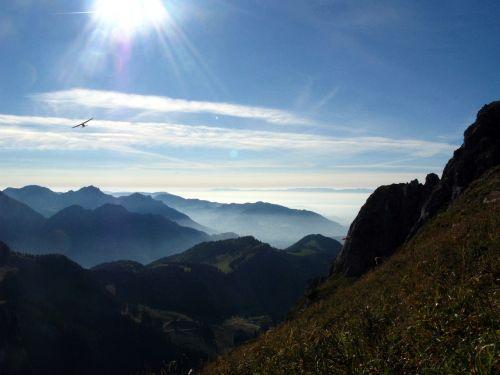 mountain airplane sky