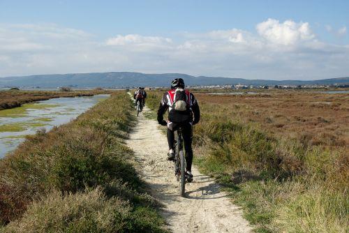 mountain biking cyclists hiking