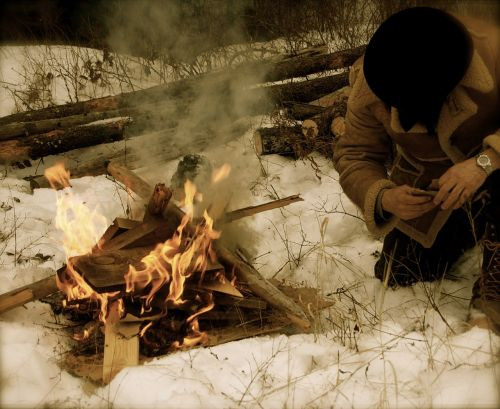 mountain man fire snow
