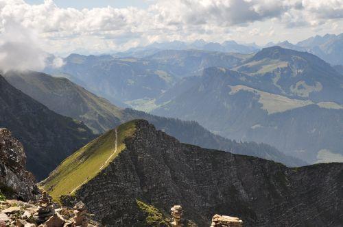 mountains summit to sneeze