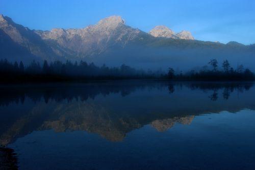 mountains water mirroring