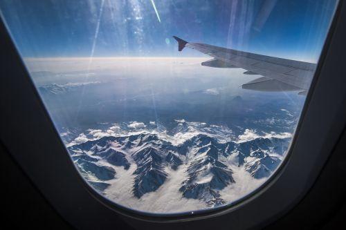 mountains plane sky