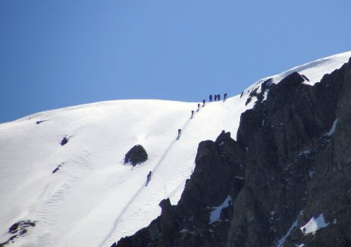 mountains climbing skiers
