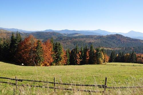 mountains  autumn  fence