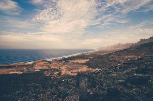 mountains landscape,seaside,landscape,mountain,travel,sky,sea,outdoor,beautiful landscape,explore,ocean,hiking,nature