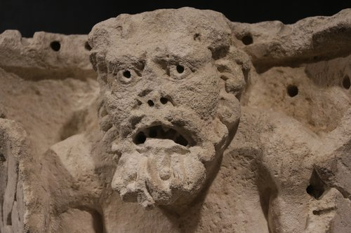 museum of romanity nimes  gargoyle  bas-relief of a roman