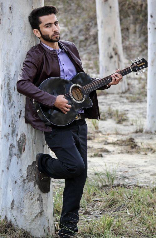 musician man guitar