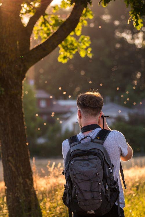 nature photographer back light young man