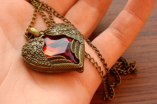 necklace with winged heart heart in hand winged heart